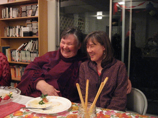 Anandaprem and Amara share a giggle at dinner in the community kitchen.