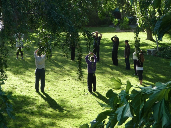 "Ananda members practice Parmhansa Yogananda's ""Energization Exercises"" before a meditation in the community temple. Click to enlarge."
